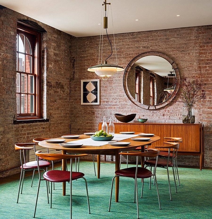 Vintage funiture and a brick wall backdrop shape the unique dining space