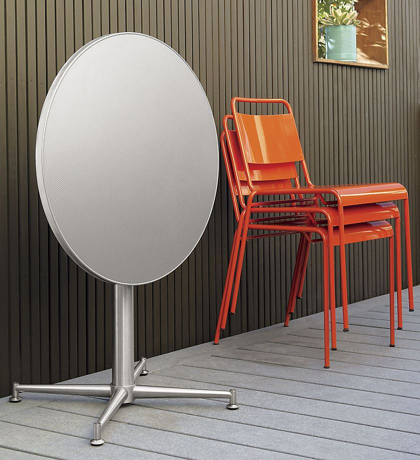 Vivid orange stacking chairs from CB2 Bright Colors Shine in the 2015 Spring Collections