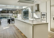 White kitchen brings a touch of minimalism to the classic Victorian townhouse