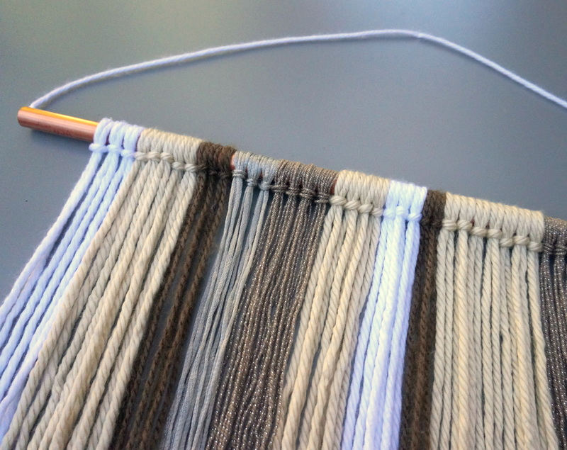 Yarn wall hanging in neutral tones