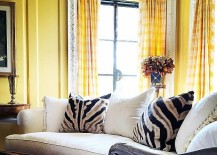 Yellow living room with zebra hide accent pillows