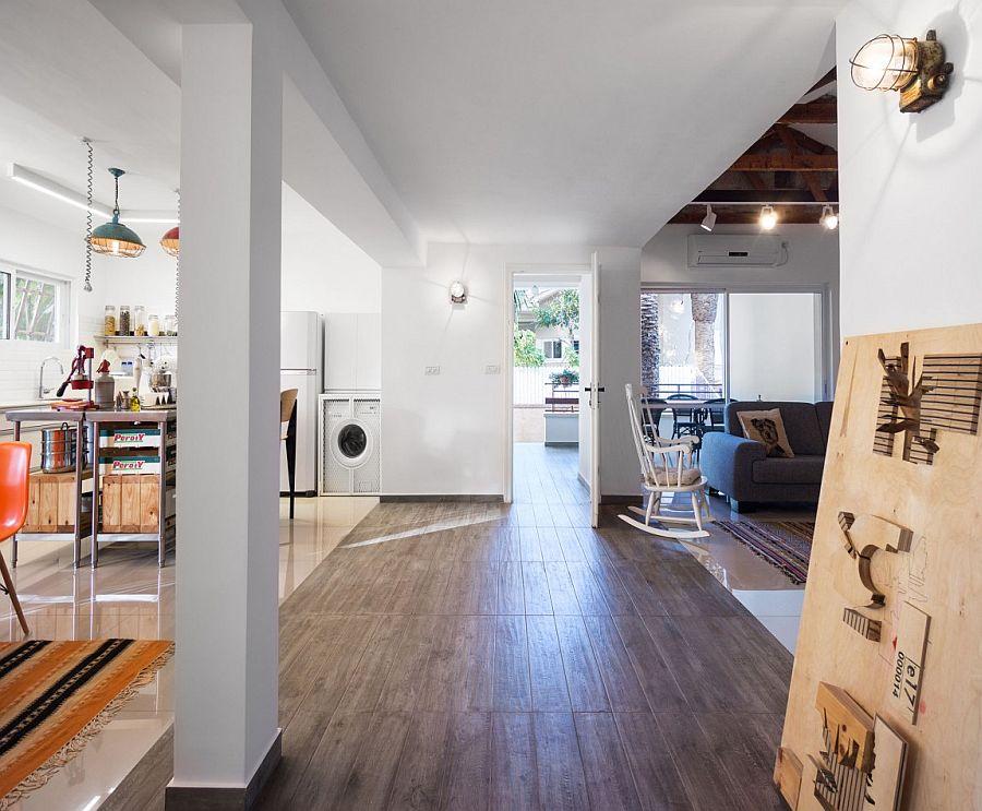 A change in flooring helps demarcate spaces in an open floor plan