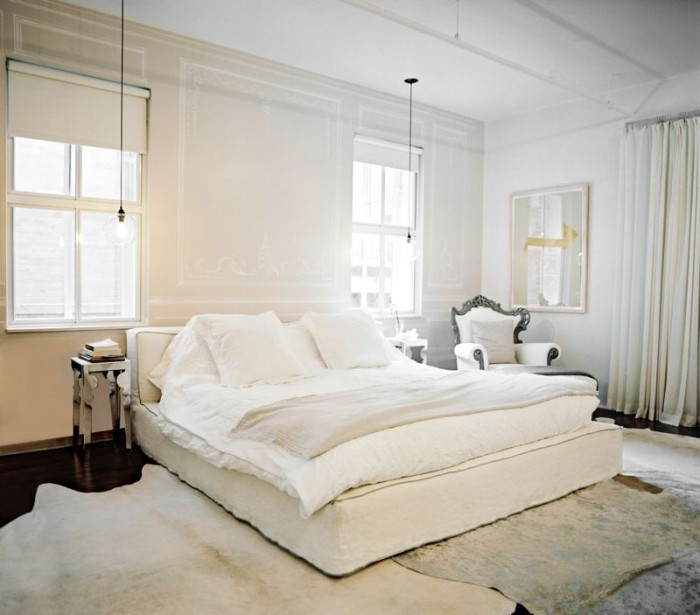An all-white room and blackout curtains equal restful