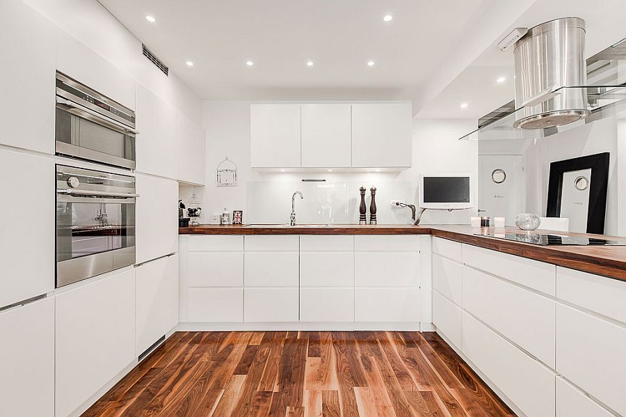 All white kitchen cabinets add to the minimal appeal of the design