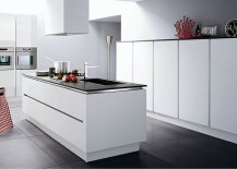 All-white kitchen with stainless steel countertops