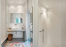 Bathroom in white leads way towards the private gardens