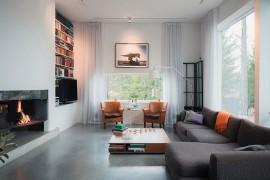 Scenic Landscape and Modern Aesthetics Shape Inspired Swedish Home