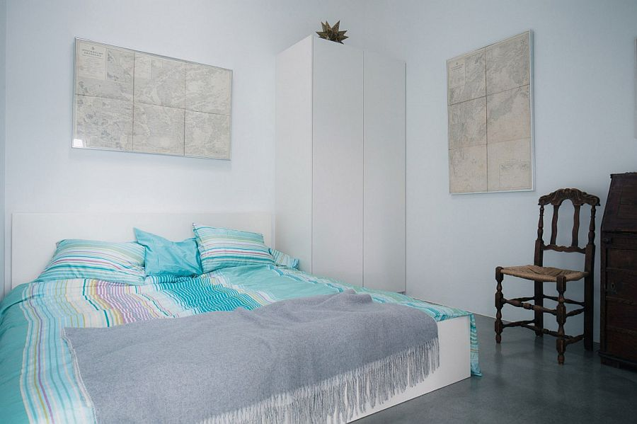 Bedding brings a touch of blue to the cool bedroom