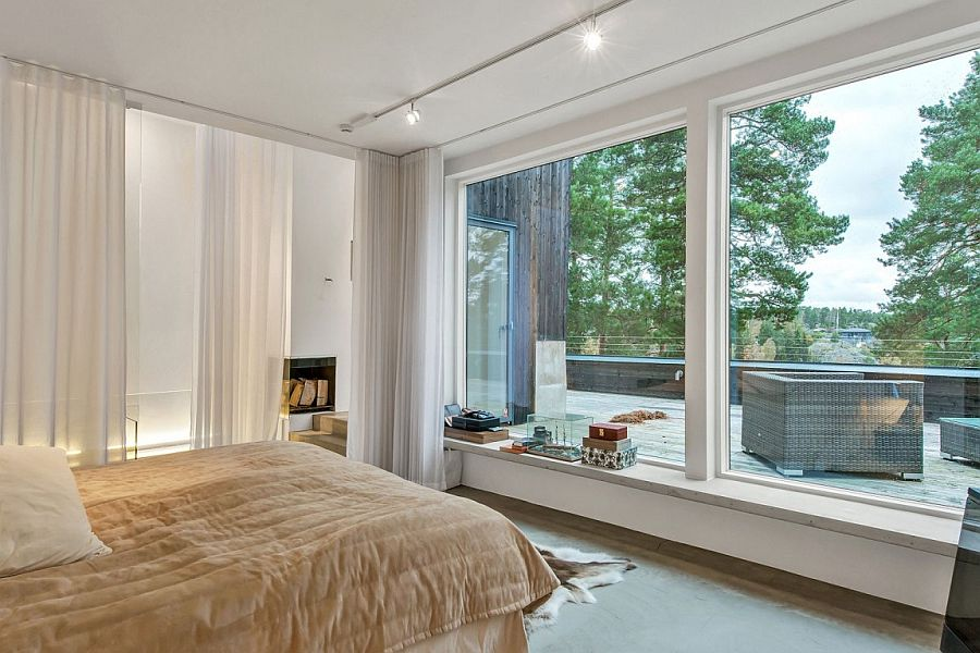 Bedroom with private deck that offers a view of the landscape