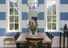 Blue and white stripes in the dining room give it a cheerful look