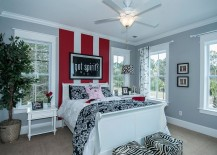 Bold stripes in red create an instant focal point in the room
