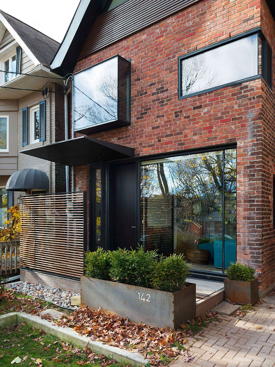 Brick and glass exterior of the renovated Toronto home