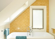 Bright yellow accent wall for the small attic bathroom in white
