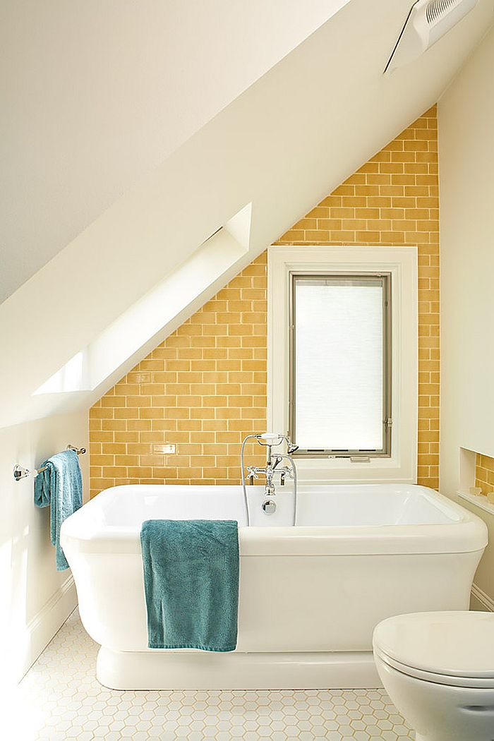 Bright yellow accent wall for the small attic bathroom in white [Design: Renewal Design-Build]