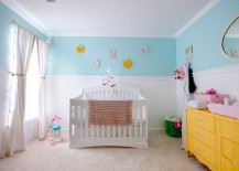 Charming nursery in white, light blue and yellow