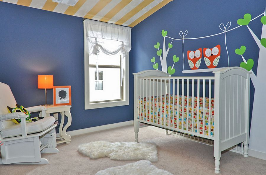 Chic contemporary nursery in newburyport blue with cool wall decal [Design: Signature Homes]