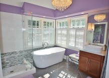 Chic purple bathroom with frameless glass shower area