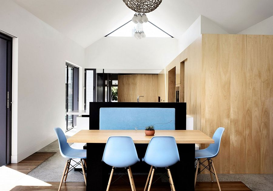 Classic Eames chairs add a touch of blue to the interior