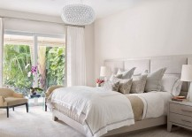 Classy Caboche chandelier enlivens the serene bedroom