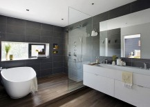 Classy bathroom in cool gray and white with standalone tub