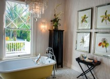 Claw-foot bathtub adds yellow to the relaxed bathroom in beach cottage