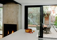 Concrete-block-and-fireplace-give-the-space-a-a-unique-focal-point-217x155