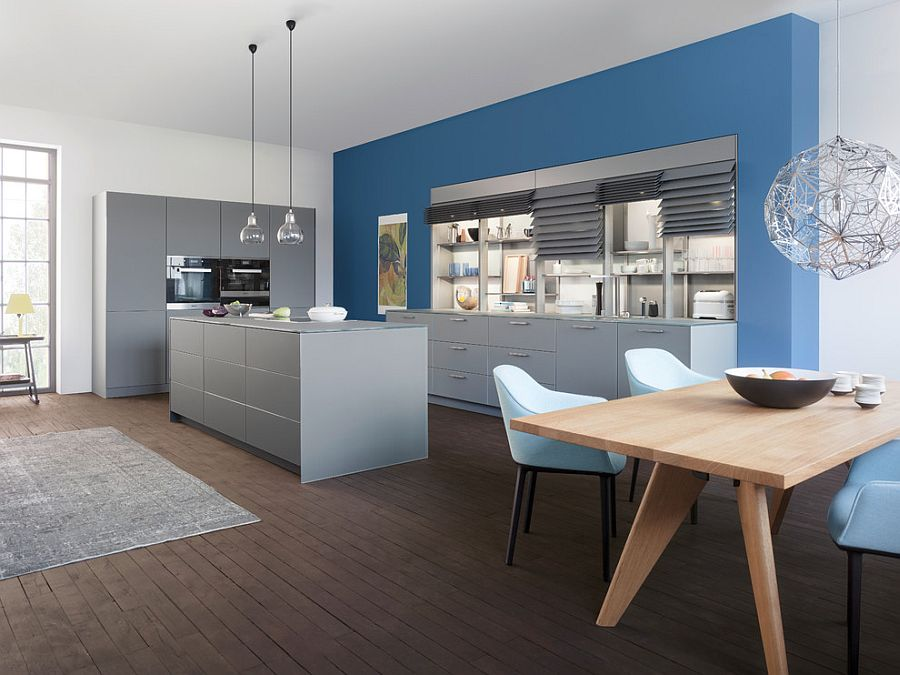 Contemporary kitchen composition with sleek gray shelves and a blue backdrop