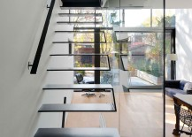 Cool floating staircase adds to the contemporary appeal of the interior