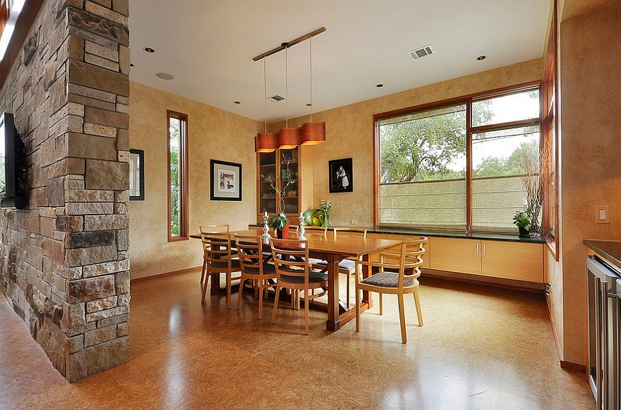Cool pendant adds to the color scheme of the dining room [Design: Cornerstone Architects]