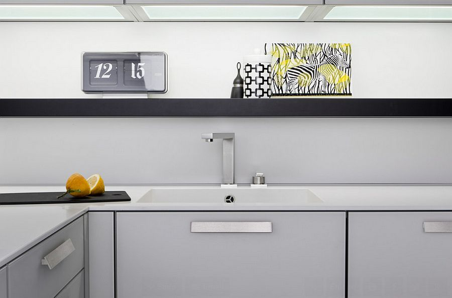 Corner cabinets and sleek floatings helf make smart use of space