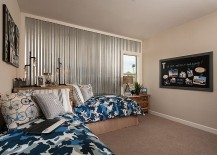 Corrugated metal wall adds an interesting visual to the elegant kids' bedroom