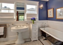 Craftsman style bathroom with bathtub in black and purple walls