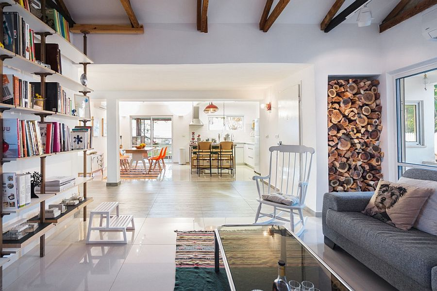 Creative way to store and display firewood in the chic Israeli apartment Cheerful Modern Renovation Transforms 50's Israeli Residence