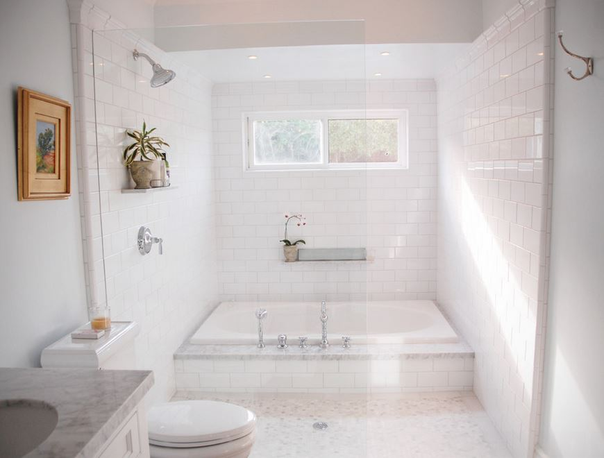 Crisp white bathroom with a sparkling tub