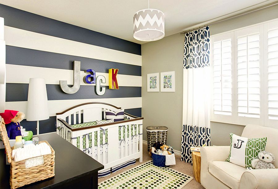 Curtains bring additional color and pattern to the stylish nursery [Design: J & J Design Group]