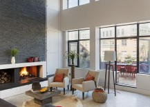 Custom fireplace with warm stone texture in the living room 217x155 Renovated Family Loft in Boston with Fresh, Urbane Aesthetics