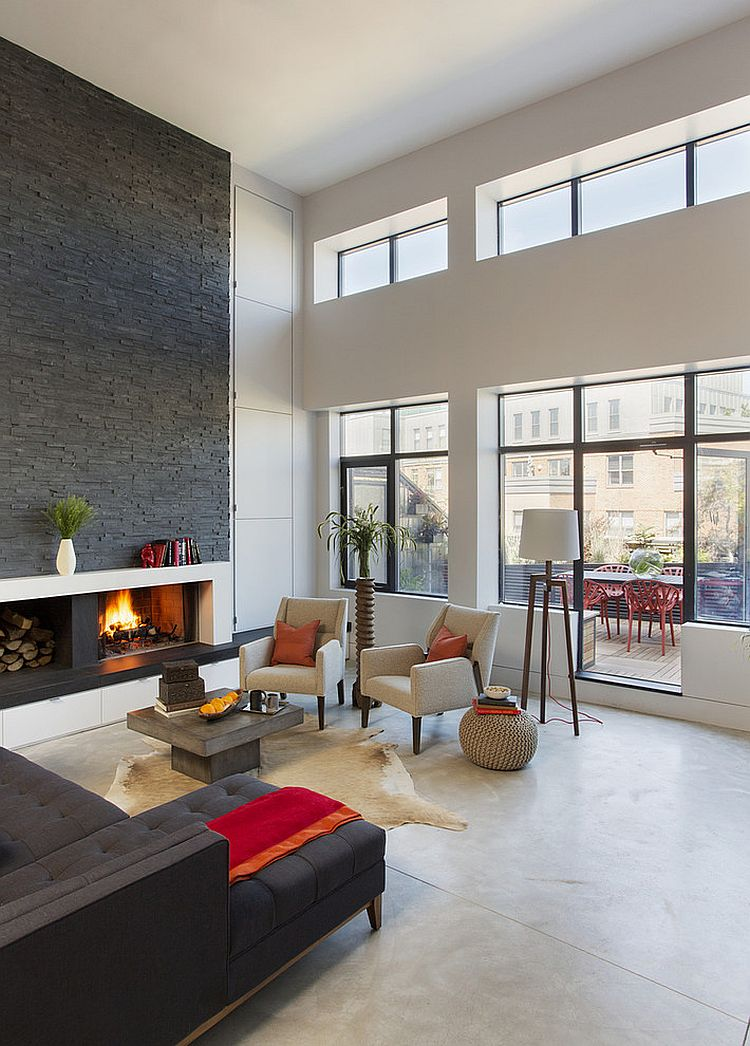 Custom fireplace with warm stone texture in the living room
