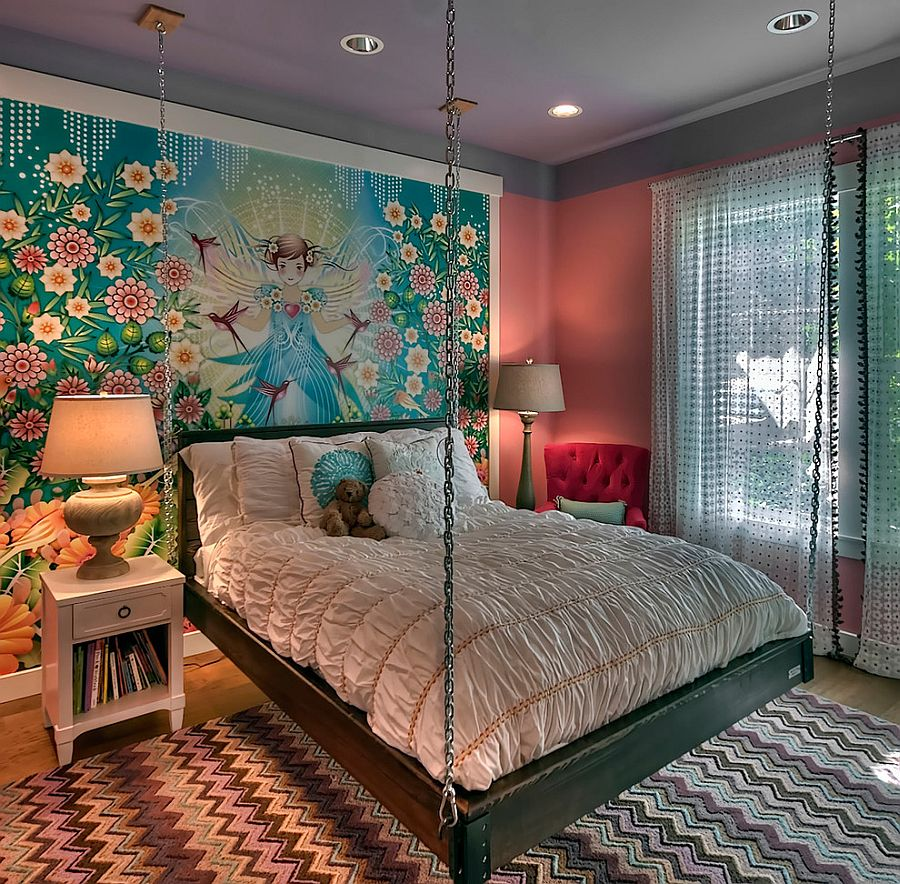 Custom wall mural and hanging bed create an ingenious girls' bedroom