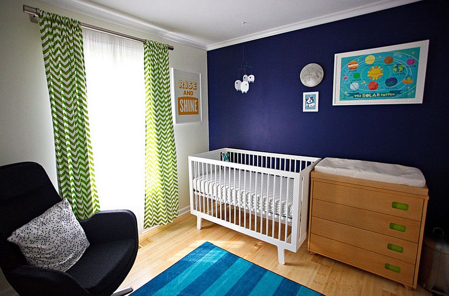 Dark blue accent wall in the kids' nursery [Design: Mary Wyar]