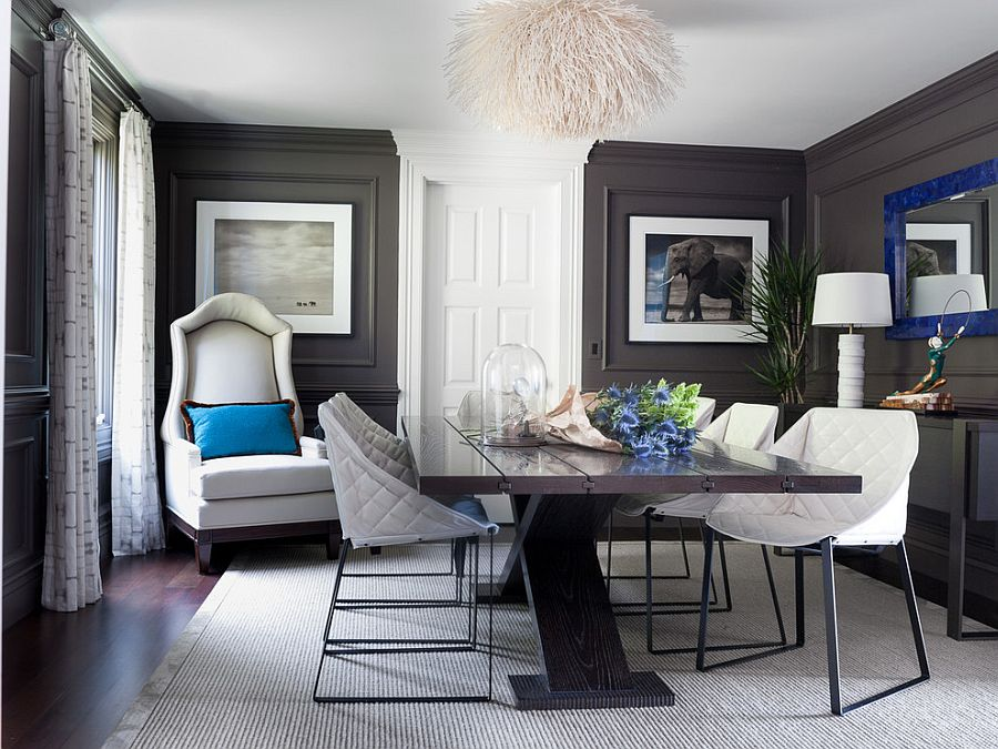 Dark gray walls and royal blue accents in the classy dining room [Design: Green Couch Interior Design]