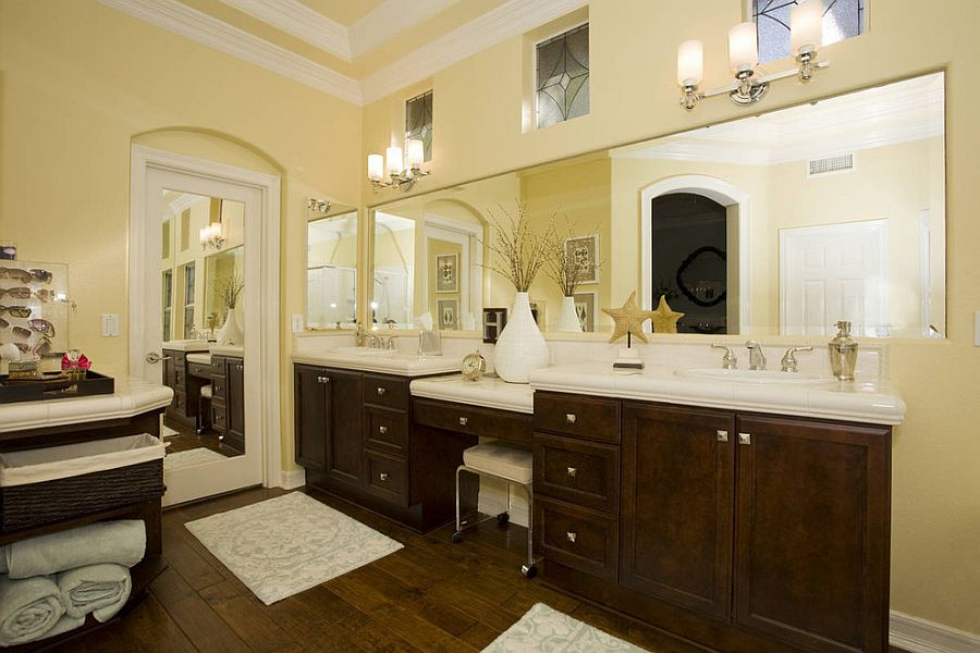 Dark walnut vanity adds to the warmth of the bathroom [Design: Savvy Interiors]