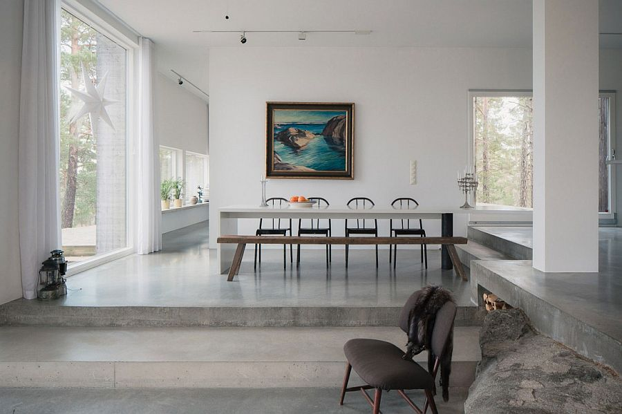 Dining area with a long wooden bench and modern chairs