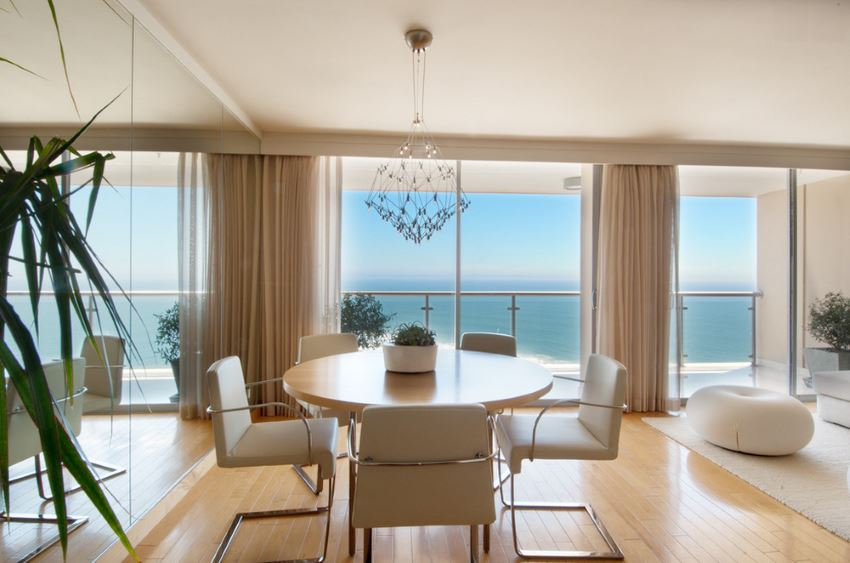 Dining room with a mirrored wall and an ocean view