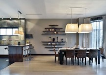Drapes-add-to-the-gray-aura-of-the-dining-space-217x155