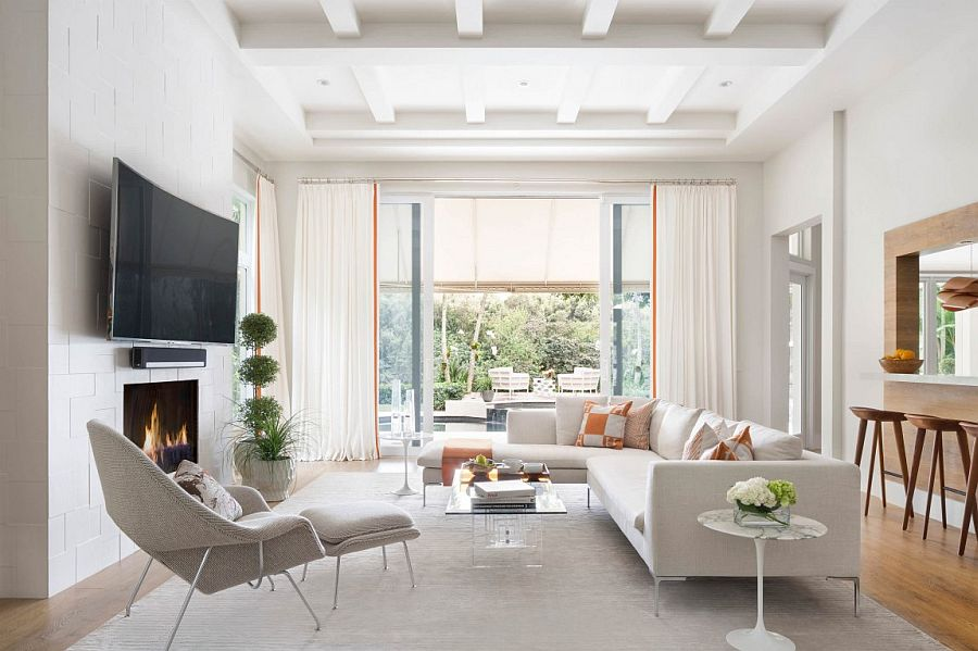 Drapes and cool color scheme give the room a cozy appeal