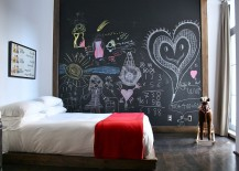 Eclectic kids' bedroom with chalkboard accent wall