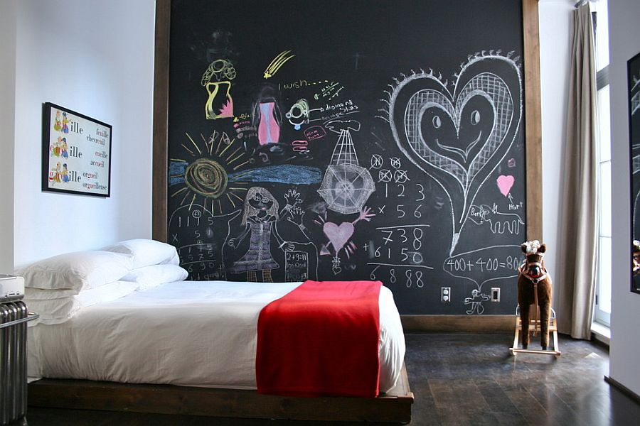 Eclectic kids' bedroom with chalkboard accent wall [Design: Catlin Stothers Design]