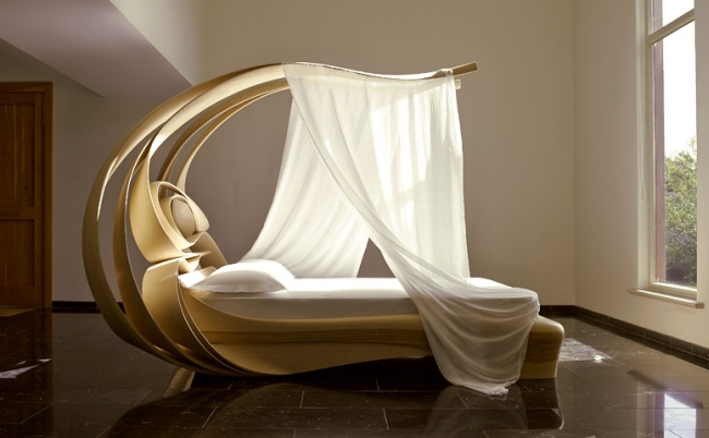 Organic in shape, this high-end canopy bed is beyond unique
