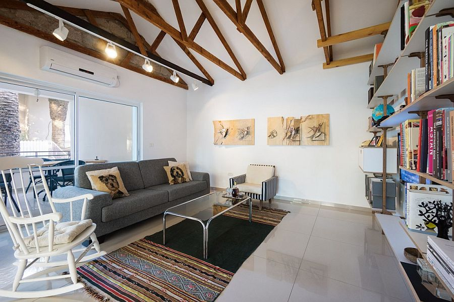 Exposed wooden beams add a touch of timeless charm to the living area