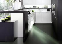 Exquisite-counter-design-combines-breakfast-zone-with-worktop-beautifully-217x155